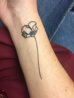 What does poppy flower tattoo mean? We have poppy flower tattoo ideas, designs, symbolism and we explain the meaning behind the tattoo. Simple Poppy Tattoo, Poppy Tattoo Small, Black Poppy Tattoo, Tattoo Designs Wrist, Flower Tattoo Designs, California Poppy Tattoo, Piercing, Poppies Tattoo, Tattoo Flowers