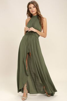Escape into your own private lagoon in the Secret Hideaway Olive Green Halter Romper! Woven rayon sweeps across a tying halter bodice and elasticized open back. A maxi skirt with front slit tops fluttering shorts for a bold finish.