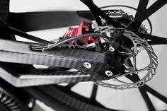 Audi Electric Bike - Closeup of the rear wheel.  Avid Code hydraulic caliper w/ Cleansweep 3 Floating rotor.