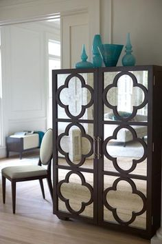 A truly defining piece, the Haven Cabinet by Bernhardt Furniture will create eye-catching drama wherever it is placed. With an elegant quatrefoil design in a rich Raven finish over antique mirror door fronts, this gorgeous cabinet is impossible to miss. Behind the doors are two adjustable/removable shelves and one center fixed shelf which allows you to customize your storage and maximize functionality. The Haven Cabinet by Bernhardt Furniture's versatile design is at home in a dining room…