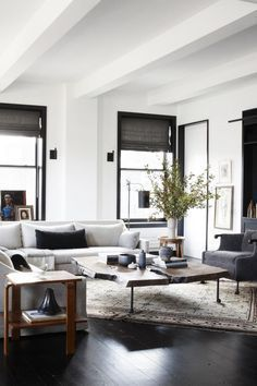 Neutral industrial modern living room in New York City loft on Thou Swell @thouswellblog