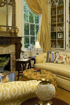Rich yellows with lots of fabric. Perfect for tea and conversation. Love the drapery swag.