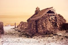 A photo of an old cottage which is right at the edge of the shore at Dunmorran Strand, Co. Sligo. I think its part of an old clachan.  Benbulben can be seen in the background.