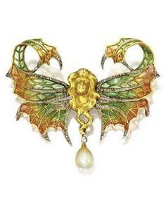 An Art Nouveau collier de chien, circa 1900, by Henri Dubret. Composed of gold, diamond, enamel, demantoid garnet, orange garnet and velvet.