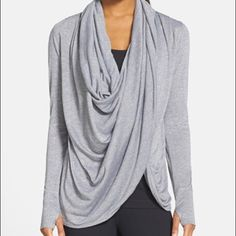Zella wrap around cardigan Wrap around cardigan with endless styling opportunities: after working out or with jeans! Can wear open, wrapped around the waist or neck. 50/50 polyester/rayon Zella Sweaters Cardigans
