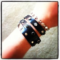 Triple Wrap Bracelet. Riveted with silver, black, and rhinestone studs with a nickel button-stud closure $36