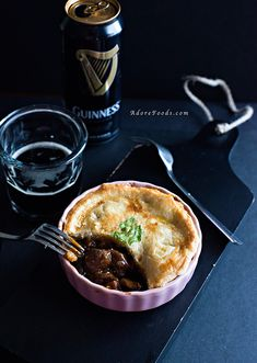 Beef and Guinness Pie. Best pie for St. Patrick's Day! Tender chunks of delicious beef, mushrooms, carrots and shallots simmering in a rich Guinness sauce topped with crusty puff pastry