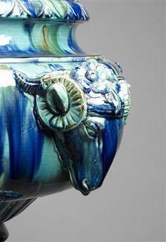 Ceramists Greber Charles (1853-1935) and Greber Pierre (1896-1965).  This goat's head is a detail of a large vase set on a column made of turquoise and blue glazed ceramic.
