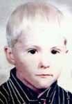 "Adrian McNaughton   Missing since June 12, 1972 from Lake, Brougham Township, ON, Canada   Classification: Endangered Missing  The Doe Network: Case File 1968DMON  Date Of Birth: November 4, 1966  Age at Time of Disappearance: 6 years old  Height and Weight at Time of Disappearance: 91 cm (3'0""); 16 kg (35 lbs)  Distinguishing Characteristics: White male. Blonde hair; brown eyes. Slight build.  Marks, Scars: Scar - 2 inches long on forehead - over which eye is unknown."