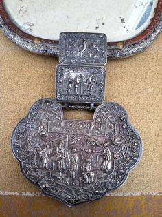 Stunning Qing silver lock necklace re-purposed into a mirror... wonderful piece!