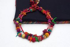 Mishmash 4, ethnic statement fiber art necklace, hand wrapped with felt, wooden, and acrylic beads. Colorful: red, blue, orange, yellow, fuchsia,