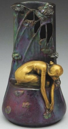 Art Nouveau vase with nymph and flowers.