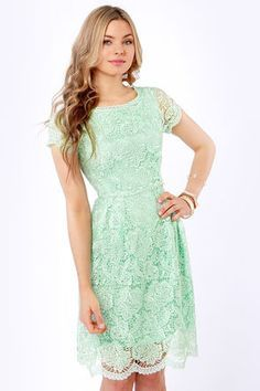 Minty green lace is beautifully embroidered all over this lovely midi-length dress, with sweetly scalloped edges along the crew neckline, sheer short sleeves, and hemline, as well as an open back cutout that'll put a little twinkle in your eye.