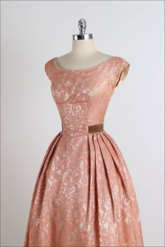➳ vintage 1950s dress  * bronze/salmon lace * acetate and tulle linings * velvet waistband with bow * metal back zipper  condition | excellent  fits like xs/s  length 45 bodice 15 bust 36 waist 26  ➳ shop http://www.etsy.com/shop/millstreetvintage?ref=si_shop  ➳ shop policies http://www.etsy.com/shop/millstreetvintage/policy  twitter | MillStVintage facebook | millstreetvintage instagram | millstreetvintage  5065/1518