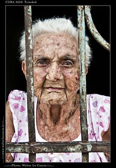 Trinidad Cuba..beauty in age, wisdom, old lady, wrinckles, aged, lines of Life, cracks in time, weathered, beauty, Behind bars, powerful face, intense eyes, portrait, photo