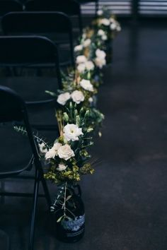 Growler bouquets for the tall centerpiece at tables