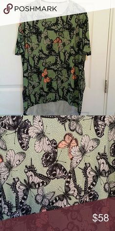 BRAND NEW LULAROE XXS IRMA Beautiful XXS Irma. It has gray & coral butterflies with a green background. Hides your front & back very well. Pairs great with leggings & jeans! Same material as the leggings! Find me on Mercari LuLaRoe Tops Tunics