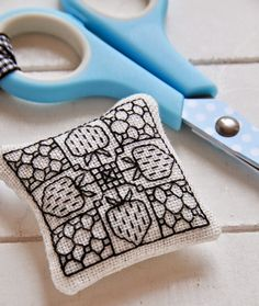 Helen Philipps' sweet blackwork pincushion is inspiring us to practice this stylish technique more!