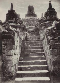 Man at Borobudur temple, Central Java, Indonesia, circa 1910.