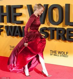 The queen of glamour: Margot's dramatic train blowied behind her in the breeze as she hit the red carpet