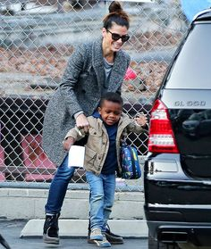 Sandra Bullock and son Louis enjoy a playful moment when she picked him up from school.