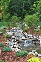a Waterfall Garden These unique water features bring a spirit of adventure to your backyard.These unique water features bring a spirit of adventure to your backyard. Backyard Water Feature, Ponds Backyard, Backyard Waterfalls, Garden Ponds, Backyard Ideas, Backyard Stream, Sloped Backyard, Koi Ponds, Garden Oasis