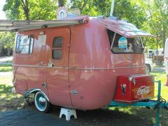 Light raspberry colored camper