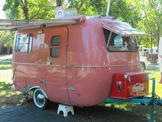 Light raspberry colored camper