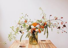 """Tiny tomatoes, rose hips and marigolds make this a forever fall favorite. Photo by @amywennerlind #fallequinox"""