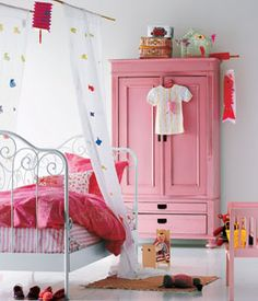 Love the painted pink armoire / wardrobe although I would paint it blue, green or yellow for my daughter's room