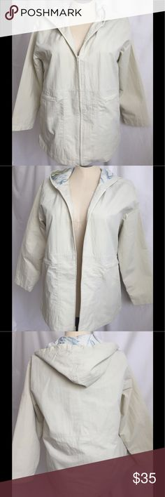 Tommy Bahama Cream Zip Front Hooded Jacet  Small This is a Tommy Bahama light yellow  cream ( reminds me of a soft white lightbulb ) hooded beach/windbreaker jacket.  It zips up the front and has two zipper pockets.   The jacket is lined in a blue palm print on the inside. Size: Women's Small ContentShell 60% cotton, 40% nylon; Lining 100% cotton; Sleeves 100% Acetate MeasurementsShoulder to shoulder 19 Sleeve length from top of shoulder 20 1/2  Chest 44  Overall Length 25 1/2…