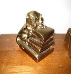 {vintage brass doxie bookends} how cute are these, chewing on a stack of books!