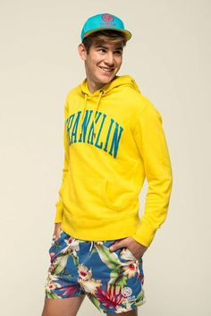 Yellow Hoodie styled with Blue Floral Shorts and one can complete the outfit by wearing Light Blue Espadrilles