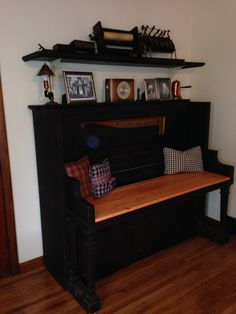 Bench- 1915 Newton Player Piano repurposed into an entryway bench. Piano top made into shelf (shown above) to display the player piano parts.