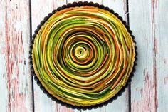 SPIRAL VEGETABLE TART COOK MINUTES Thinly sliced summer vegetables are the visual star of this spiral vegetable tart. With a layer of homemade sundried tomato pesto and a flaky pie crust, this tart is as delicious as it is beautiful. Vegetable Tart, Vegetable Sides, Vegetable Recipes, Grilled Okra, Best Superbowl Food, Roasted Tomatillo Salsa, Sundried Tomato Pesto, Easter Appetizers, Appetizer Recipes
