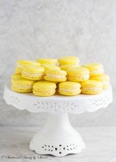 Lemon French Macarons- perfect spring-flavored confections with zesty lemon buttercream that you can make right at home with my new video tutorial!