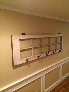 Old French door picture frame with antique hinges and hooks. DIY project.