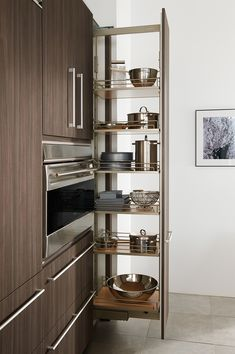 Tall pull-out pantry, as shown in the contemporary Expressions kitchen by #WoodMode.