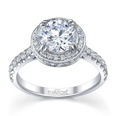 Vatche Pave Halo Diamond Engagement Ring - This diamond engagement ring by Vatche has round brilliant cut diamonds set along the top and sides of the halo which surrounds the center diamond of your choice as well as down the shank.