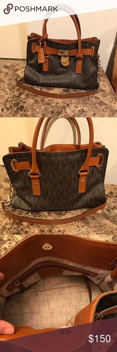 Michael Kors Signature Hamilton Handbag-brown Michael Kors Signature Hamilton Handbag in brown. Still in pretty good condition. The handles have some scratches and a little wear and tear. But in general the bag is still looking nice. Purchased for $298 selling for $130 Michael Kors Bags Satchels