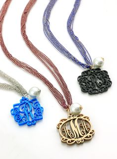 Gorgeous acrylic filigree pendants ($25) on beaded charm necklaces ($34) | Initial Outfitters
