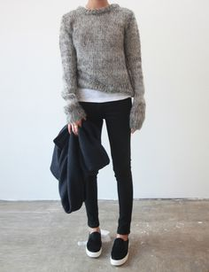 Fall / Winter - street style - layers - furry grey sweater + white t-shirt + black stilettos + black sneakers + oversized black cardigan