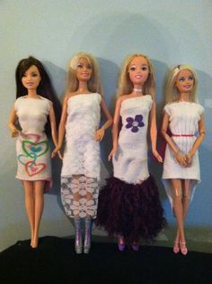 Barbie Dresses made from old mismatched socks.  -Cut the heel out and use it to make bows.  The purple skirt is fluffy yarn, the pink belt is tulle twisted tightly.  I don't recommend the lace overlay because it does not stretch well.