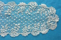 Brussels bobbin and needlelace applique on machine net