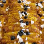 """Ground Beef Enchiladas - Corn tortillas filled with seasoned ground meat, onions, olives and cheddar cheese, baked in a not-too-spicy homemade enchilada sauce. You're sure to hear the words, """"More please!"""" around the family table."""