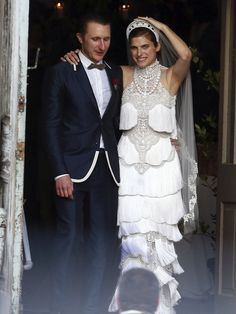 Lake Bell wore a custom Marchesa Couture gown and Scott Campbell wore Marc Jacobs when they married June 1