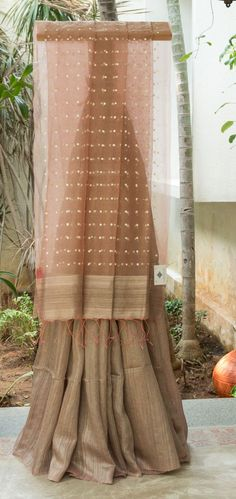 CLASSIC BEIGE AND PASTEL PINK HALF AND HALF BAILOU MATKA SILK HAS SEQUINED KORA PALLU THAT GIVES THE SAREE SUBTLE FINISH.
