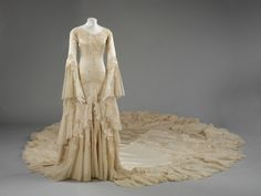 Silk satin wedding dress designed by Norman Hartnell, 1933. Given and worn by Margaret, Duchess of Argyll.