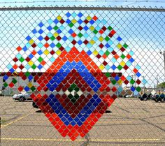 Artists Steve Bougie and Richard Fuller created a stained glass piece installation in a chain link fence