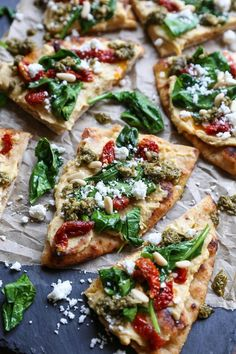 A beautiful appetizer to celebrate National Hummus Day – hummus flatbread with sun-dried tomatoes, feta, spinach, pine nuts, and pesto sauce makes for an easy-to-prepare snack. Made with Cauliflower crust. Vegan Recipes, Cooking Recipes, Free Recipes, Vegan Pizza Recipe, Potato Recipes, Vegetable Recipes, Vegetable Pizza, Best Dinner Recipes, Party Recipes
